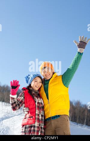 Happy young couple in ski resort - Stock Photo