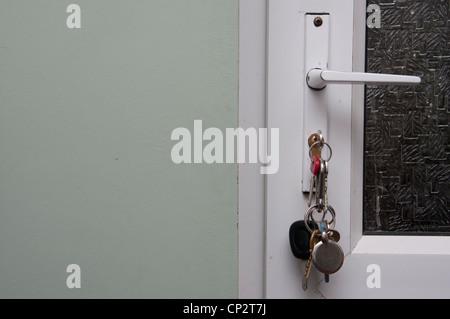 Bunch of keys in a door lock. - Stock Photo