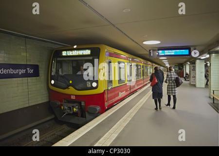Berlin Brandenburg Gate or Brandenburger Tor S Bahn station and train - Stock Photo