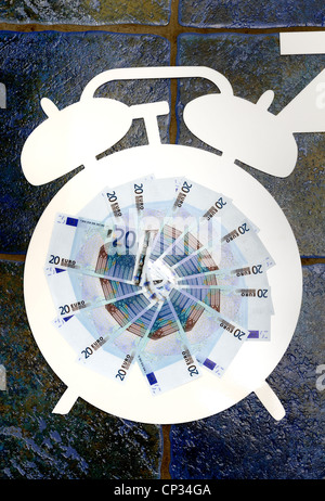 white cutout of an alarm clock with euro notes in the middle. 'times up for the euro currency'
