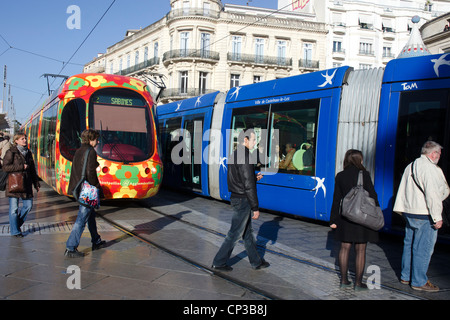 Streetcars - trams - from two different lines crossing in the center of Montpellier, France. - Stock Photo