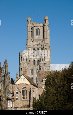 Main West Tower of Ely Cathedral Cambridgeshire England from south in sunshine blue sky - Stock Photo