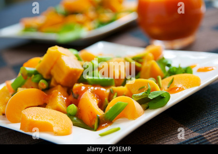 Sweet potato apricot salad with green beans and pistachios and an apricot vinaigrette. - Stock Photo