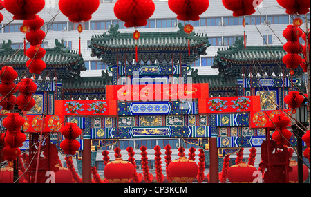 Ornate Chinese Gate  Lucky Red Lanterns Chinese Lunar New Year Decorations Ditan Park, Beijing, China - Stock Photo