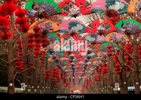 Paper Fans Lucky Red Lanterns Chinese Lunar New Year Decorations Ditan Park, Beijing, China - Stock Photo