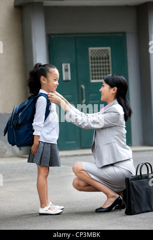Chinese mother and daughter getting ready for scool - Stock Photo