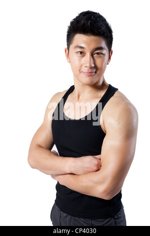 Muscular man with arms crossed - Stock Photo