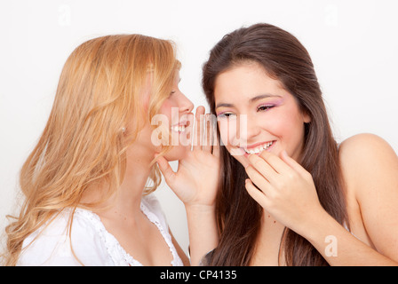 teens whispering and gossiping - Stock Photo