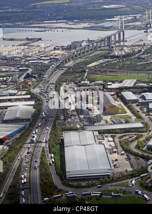 Aerial view of the M25 heading south towards the Dartford Crossing and QE2 Bridge with heavy traffic - Stock Photo