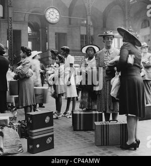 Stylishly dressed African American women at New York City's Pennsylvania Station. August 1942. - Stock Photo