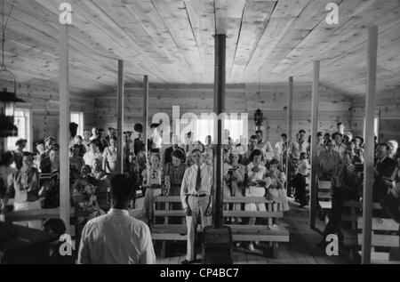 Religious service in the Pie Town, New Mexico church. Pie town was settled in the 1930's by 250 homesteader families - Stock Photo
