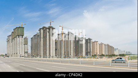 A 2 picture stitch panoramic of new construction apartment blocks next to the Nanhuan Bridge in Datong. - Stock Photo