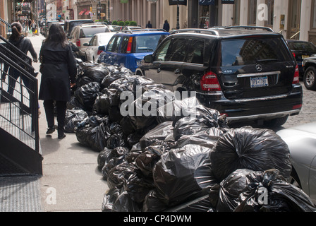 Piles of trash in plastic bags await pick-up curbside in New York on Saturday, April 28, 2012. (© Richard B. Levine) - Stock Photo
