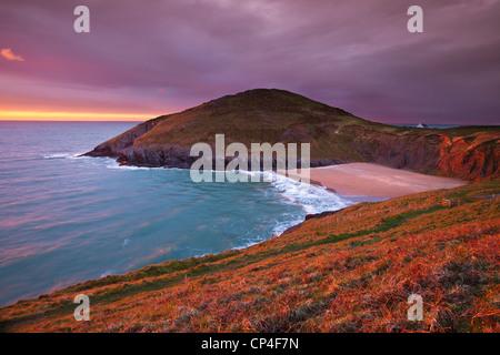 Sunset Mwnt beach and headland Cardigan bay Ceredigion coast Cardiganshire Wales UK GB EU Europe - Stock Photo