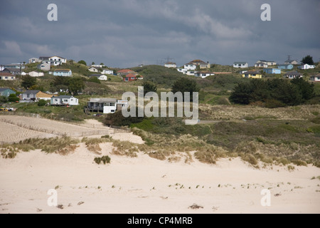 1930s holiday chalets in the sand dunes at Hayle Towans, Cornwall - Stock Photo
