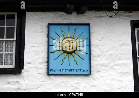 Pub sign on the Sun Inn, Dent, Cumbria, England. - Stock Photo