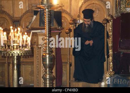 Israel - Bethlehem (Bayt Lahm) - Church of the Nativity, ext. Orthodox priest. - Stock Photo
