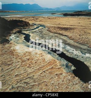 Djibouti - Lake Assal, 150 meters below sea level, salt deposits. - Stock Photo