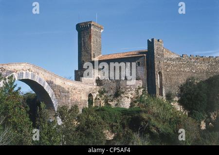 Lazio Natural Park Archaeological Vulci (Vt) medieval castle houses Museo Etrusco, bridge of abbey of Etruscan origin - Stock Photo