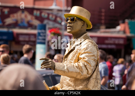 Gold man street performer on busy street - San Francisco, California USA - Stock Photo