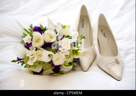 wedding shoes and flowers of the bride - Stock Photo