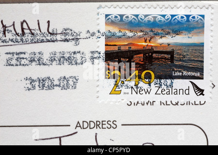 postcard from New Zealand showing New Zealand stamp with picture of Lake Rotorua for $2.40 - Stock Photo