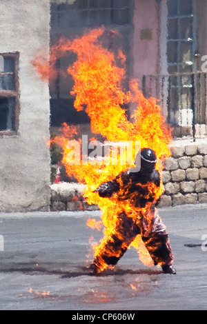 Man on fire stunt at Action, lights, motors show, Hollywood Studios. - Stock Photo