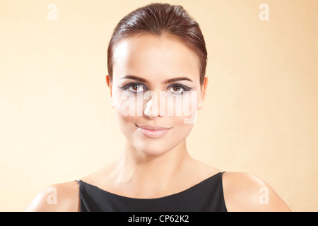 Young woman in black dress, portrait - Stock Photo