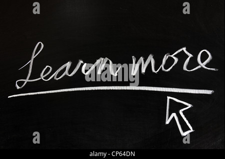 Learn more words and mouse pointer drawn on chalkboard - Stock Photo