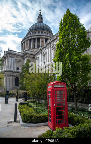 Gardens and traditional red telephone box near St Paul's Cathedral London UK - Stock Photo