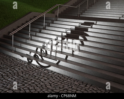 An empty wheelchair casting a shadow on stairs - Stock Photo