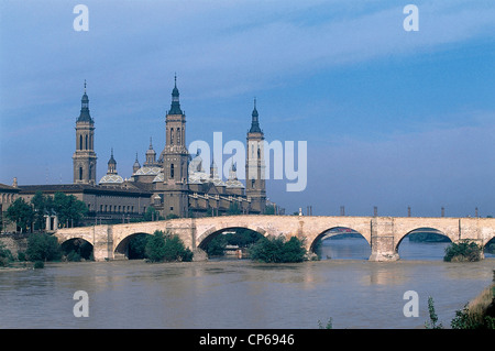 Spain Aragon Zaragoza, with views of Cathedral of Our Lady of Pillar (Nuestra Senora del Pilar) bridge over river - Stock Photo