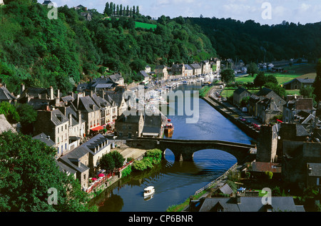 France - Brittany - Dinan, the river port and the Gothic bridge over the River Rance, seen from the viaduct. - Stock Photo