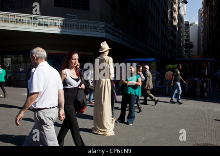 Living statue downtown Sao Paulo Brazil Mime artist posing for hours in street like a statue with realistic statue - Stock Photo