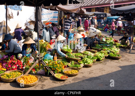 Horizontal close up of a traditional flower stall at the daily market in Hoi An Old Town, Vietnam. - Stock Photo