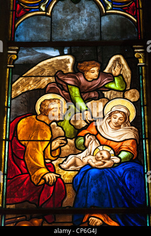 Birth of Jesus Christ stained glass window, Notre Dame Cathedral, Ho Chi Minh City, (Saigon), Vietnam - Stock Photo