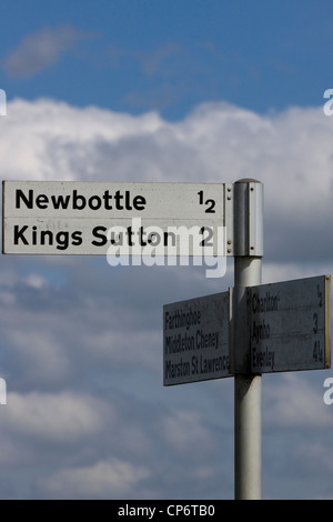 Newbottle Kings Sutton Finger post Sign in the English countryside against a blue sky - Stock Photo