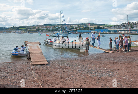 People leaving passenger ferry from Shaldon on River Teign at Teignmouth Quay, Teignmouth, East Devon, south west - Stock Photo
