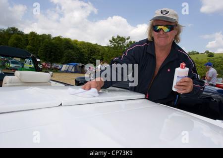 Polishing a vintage Cadillac Eldorado car exhibited at a steam rally and car show - Stock Photo