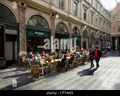 People sitting at a cafe in the Galeries St Hubert, Brussels, Belgium - Stock Photo