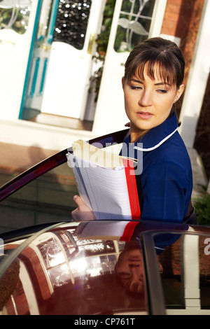 District Nurse on home visit - Stock Photo