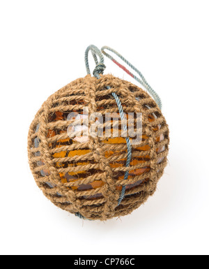 Glass fishing buoy used to keep fishing nets floating. This is an old glass antique. Isolated on white background. - Stock Photo