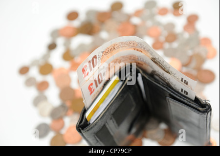 English notes and currency and a black wallet - Stock Photo