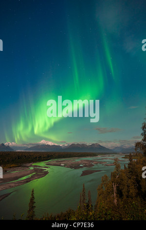 Northern lights above Mount McKinley and the Chulitna River during a full moon, Denali State Park, Alaska - Stock Photo