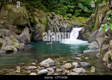 Young woman in the tropical crystal sea of playa madama - Crystal pools waterfall ...