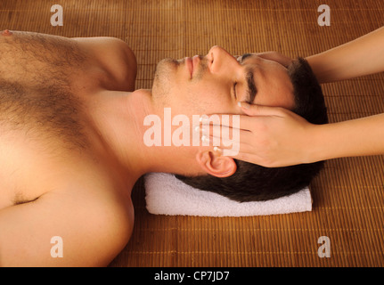 Man getting face massage - Stock Photo