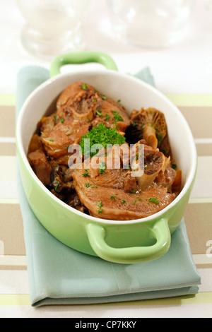 Turkey ossobuco with mushrooms. Recipe available. - Stock Photo