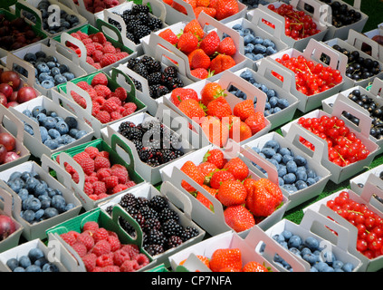 blueberries, blackberries, strawberries, raspberries, red and black currants on market in Provence, France - Stock Photo