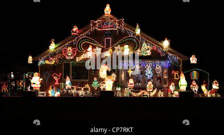 CHRISTMAS LIGHTS ON BUNGALOW RILLINGTON NORTH YORKSHIRE 30 December 2011 - Stock Photo