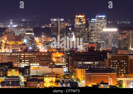 Downtown skyline of Birmingham, Alabama, USA at night. - Stock Photo